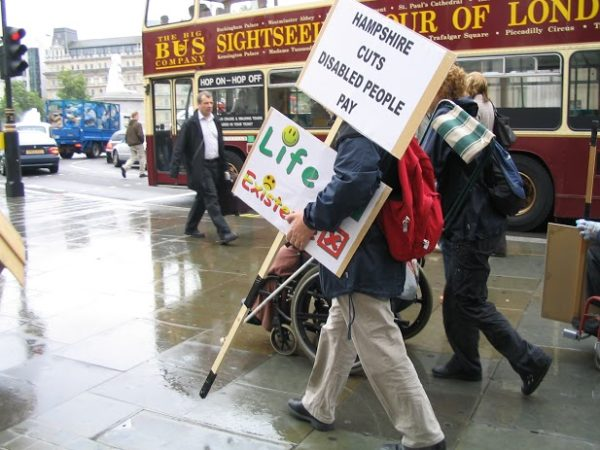 Campaigners on the street holding Hampshire Cuts placards