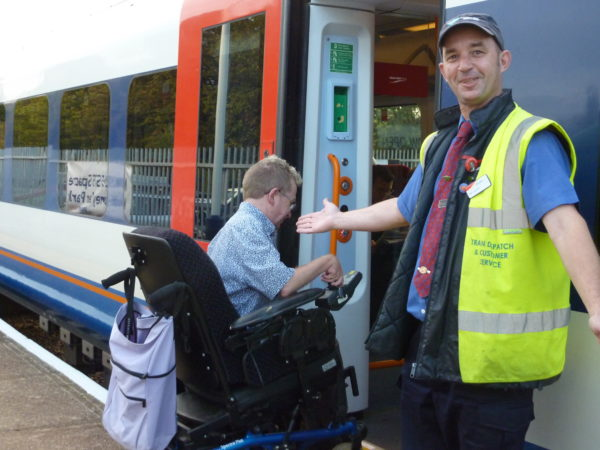 Photo of a Wheelchair user boarding a train
