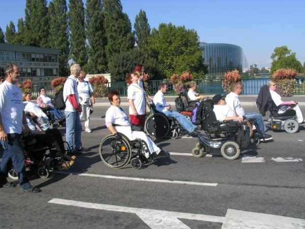 Group of Disabled People marching on a campaign rally