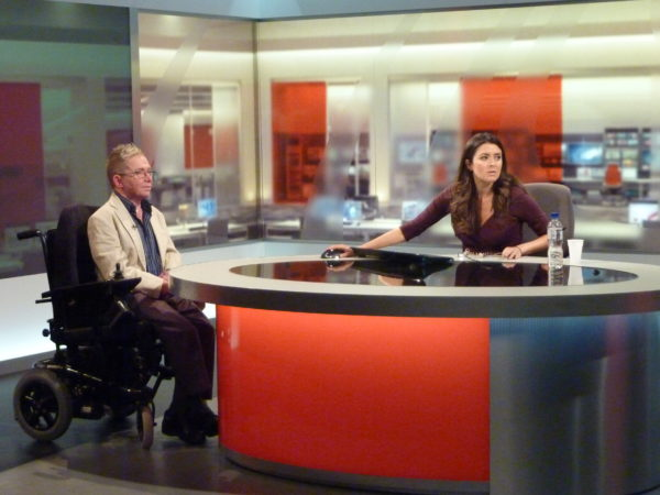Chief Executive and news presenter in TV studio