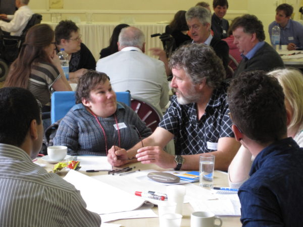 Group of people having a discussion at one of our networking events