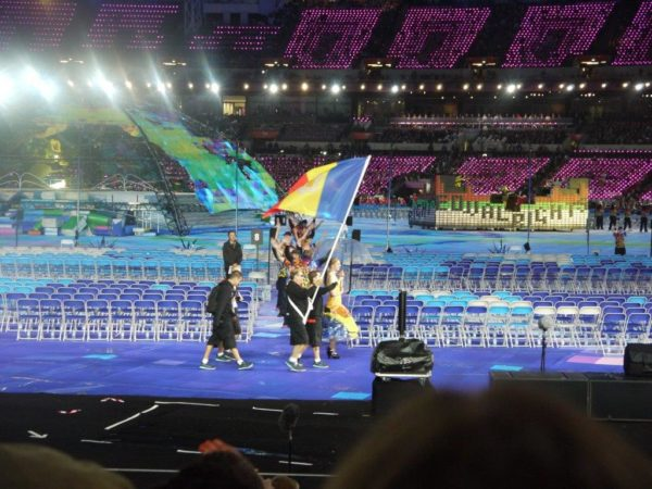 photo of athletes holding a flag at Paralympics opening ceremony