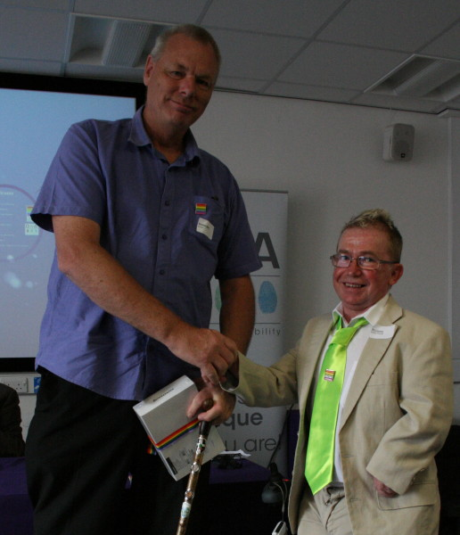 Photo of Steve Beal receiving his pize of a Lenovo tablet from Ian Loynes
