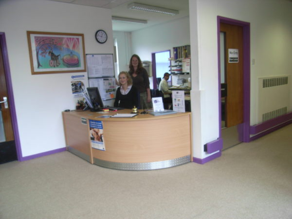 The reception desk at Unity 12 with a seated female receptionist