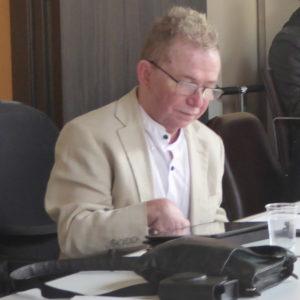 Ian Loynes working at a desk