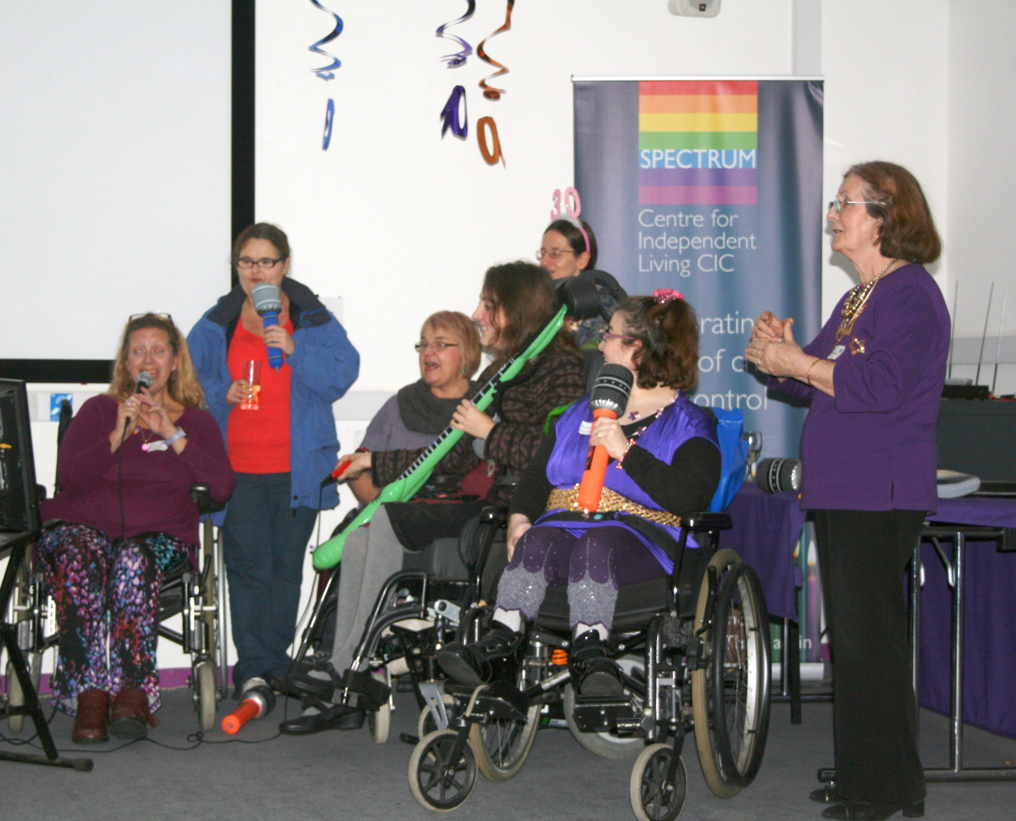 Group of Disabled People with inflatable musical instruments