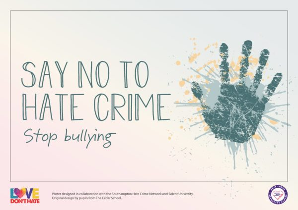 Poster of a hand with palm upturned saying SAY NO TO HATE CRIME