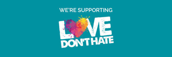Graphic on blue background with text saying Love Don't Hate