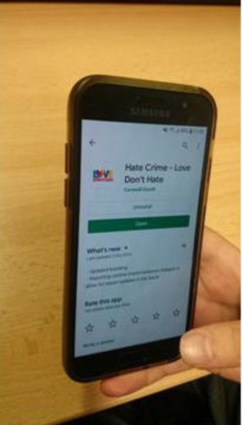 Smartphone with Hate Crime reporting app start screen